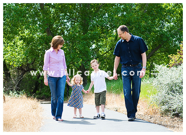 Classic family photo of a fun walk through the park.
