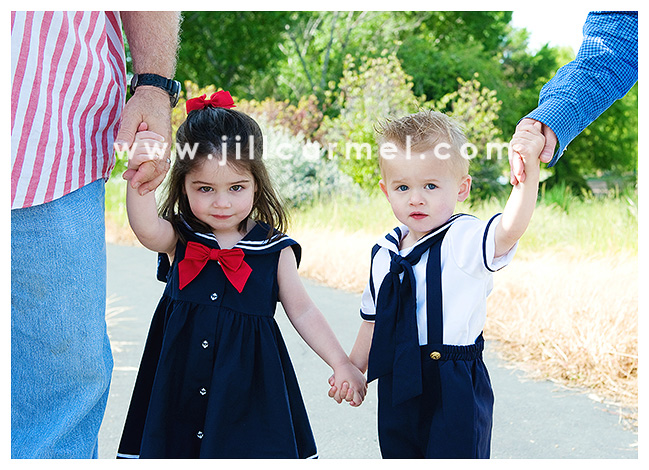 Adorable brother and sister dressed up in their Sunday best for Mother's Day photos.