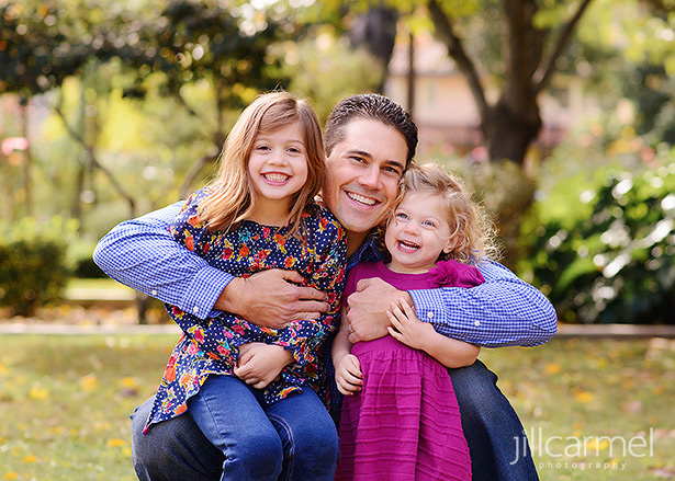 Fall family photos in McKinley Park Sacramento dad with young daughters