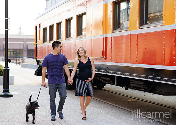 maternity portraits in Old Sacramento in front of a red train