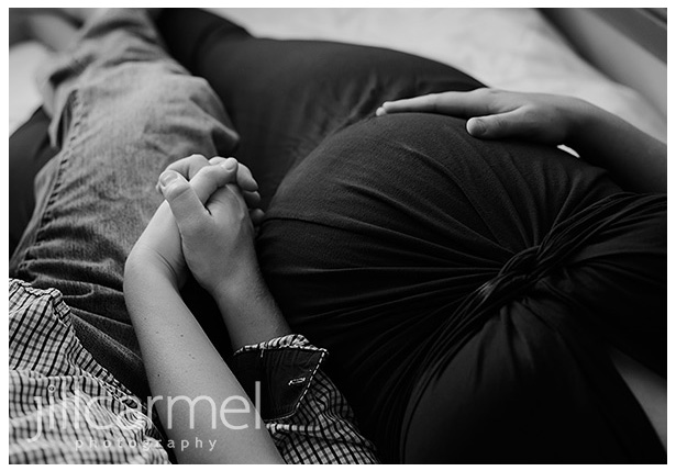 outdoor maternity session by the river black and white close up of her belly holding hands