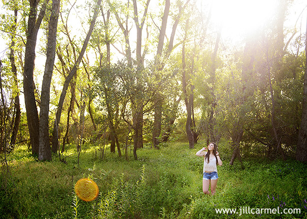 bohemian senior portraits in a field with tall grass