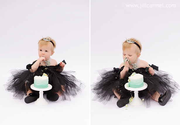 a tiny blue cake and a black tulle dress are perfect for this first birthday cake smash