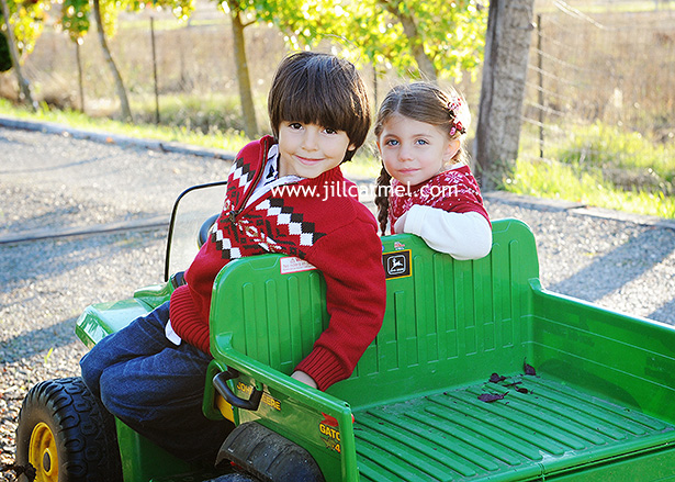 brother and sister riding the jeep at grandmas farm in elk grove