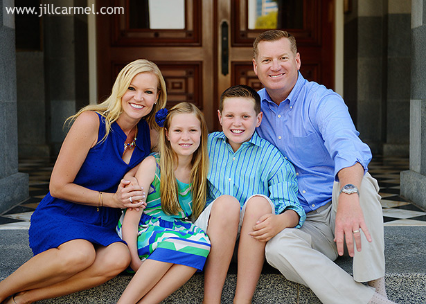 sitting on the steps of the capitol all dressed in blue for their family pictures