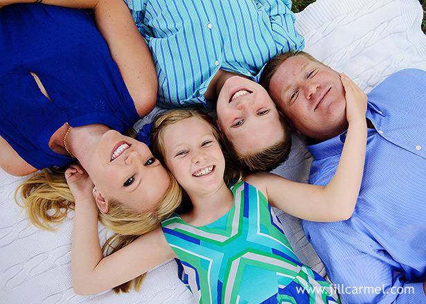 beautiful family lying on a blanket in front of the capitol
