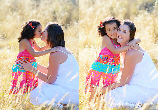 mommy and daughter hugging and kissing for maternity portraits