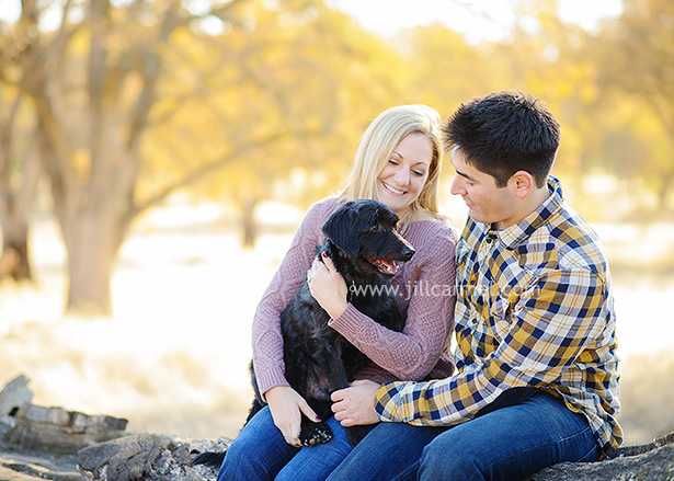 married couple picture with their dog