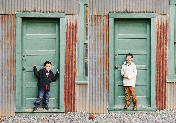 brothers standing in front of a green door at rustic empire mine