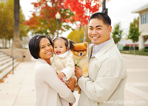 family pictures with pup in front of red tree