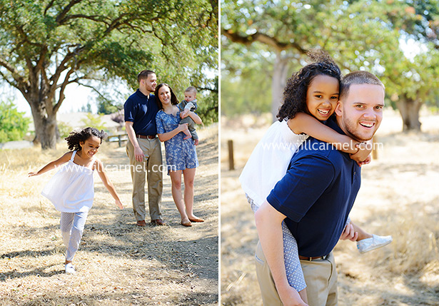 big sister runs around and gets a piggy back ride from her dad amongst the oak trees in sacramento