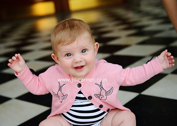 working hard to balance her new sitting-up skills and oh so cute in her pink cardigan