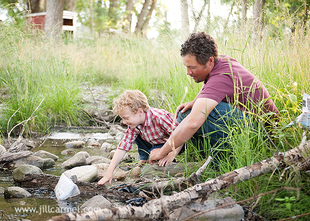 father and son by the river for pictures