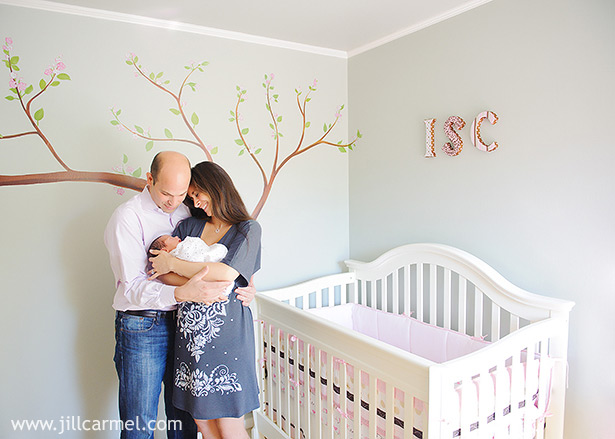 their first family photo in their beautiful nursery