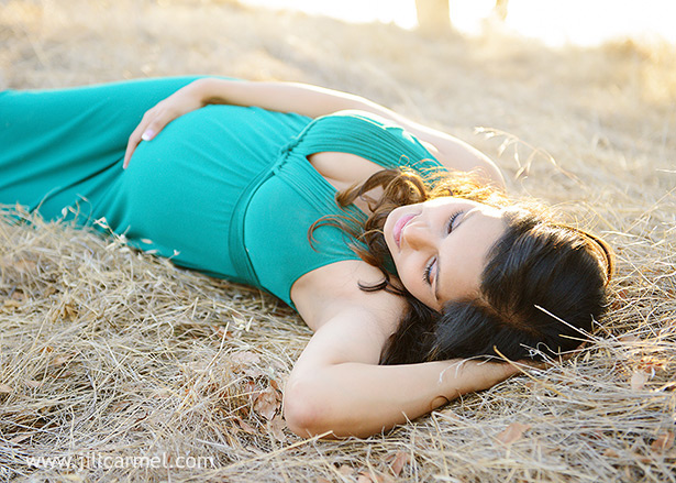 stunning pregnant mommy lying down for her maternity pictures
