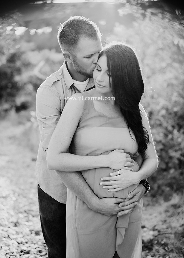 black and white image of hugging the pregnant belly