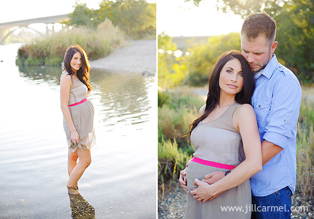 husband and wife standing together by the river in folsom for maternity portraits