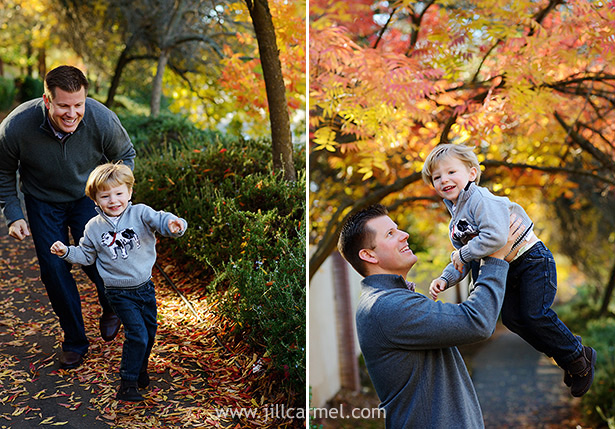 daddy chasing his son through the autumn leaves