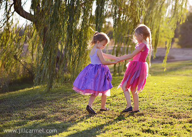 sisters play ring around the rosy under the weeping willow at gibson ranch