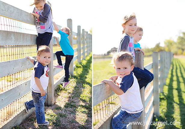 brother and sisters climb the white fence at Gibson Ranch