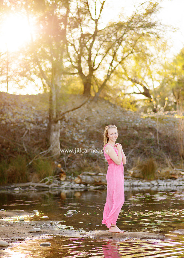pink maxi dress by the river with sunset light