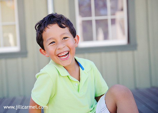 grandson with his lime green shirt and big smile at old sacramento for his pictures