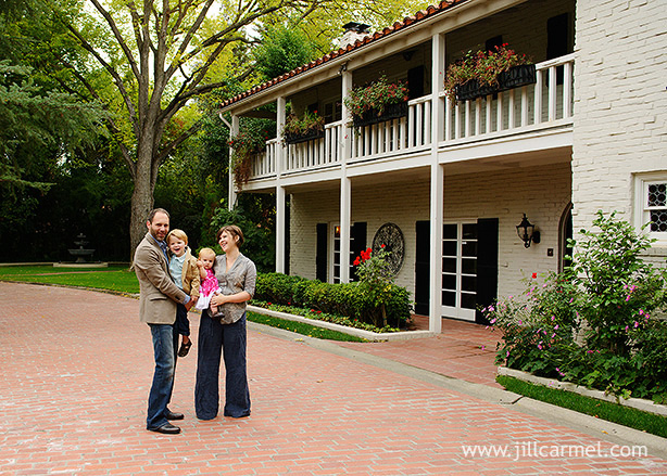 family portrait in front of their  old california style home