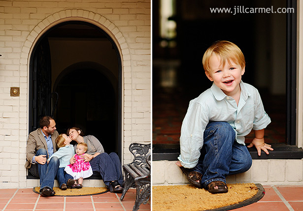 family sits in archway of their old california style home for their family portraits