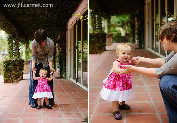 one year old learning to walk with pink dress