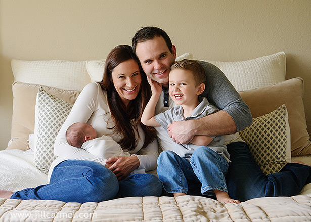 Newborn Family Photos On Bed