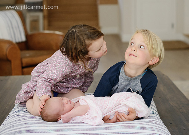 big brother and sister have a good laugh during their sister's newborn photography session | Jill Carmel