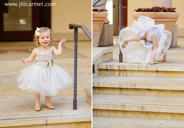 little girl climbing up the stairs in a tutu dress and ballet slippers
