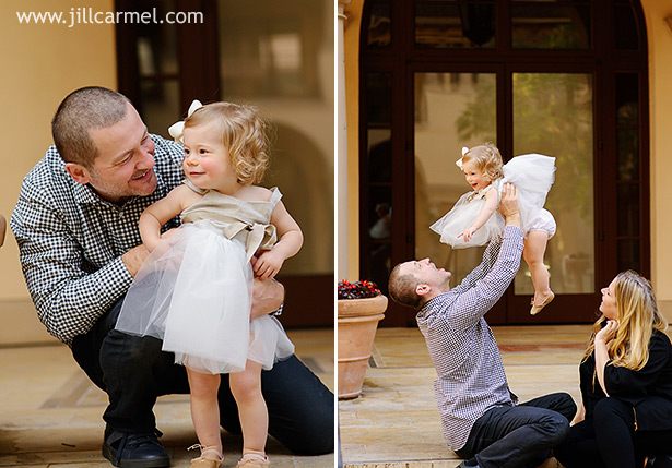playing with mom and dad on the steps in a pretty gray tulle dress