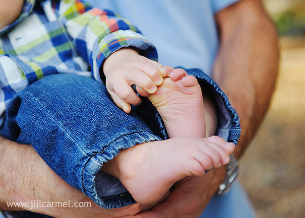 one year old baby grabbing his pudgy feet
