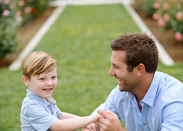 father and son at Mckinley Park for portraits and laughing