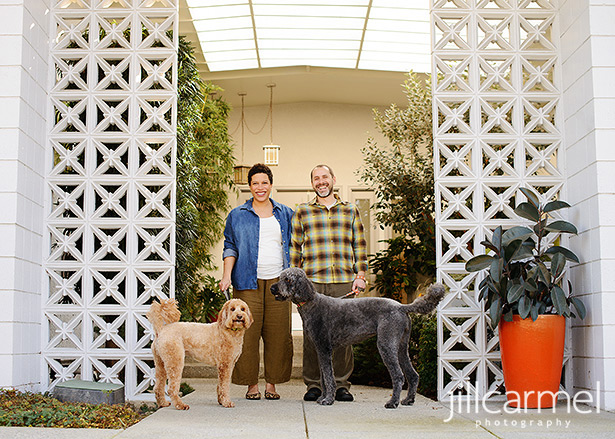 out on the front porch with designer mid-century bricks and bright orange plant pot