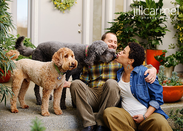 snuggles with pups for their family maternity shoot in sierra oaks