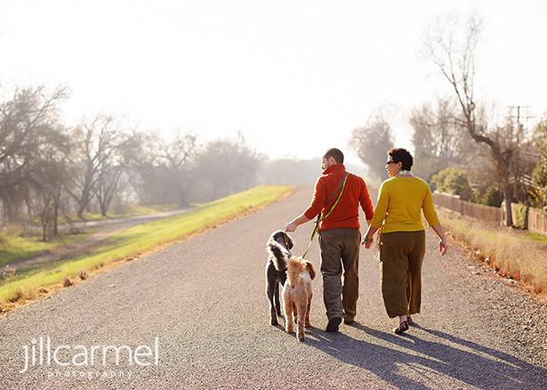 family walking along the american river in sierra oaks with dogs