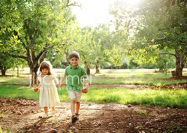 brother and sister holding hands outdoors for their pictures
