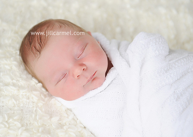 all bundled up in a swaddle for his newborn pictures