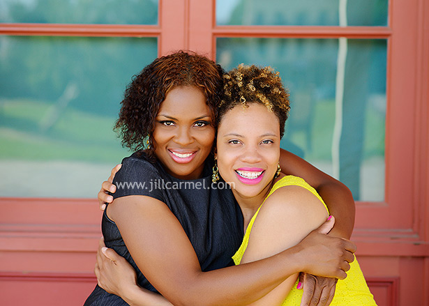 two sisters together for their photo shoot, perfect in pink lipstick and a yellow dress