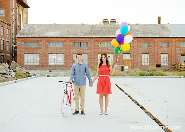dressed in anthropologie with a fixed gear bicycle and colorful balloons at the old sugar mill in sacramento