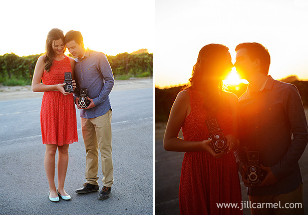 sunset shots of taking pictures with old vintage cameras and kissing in front of the setting sun at the old sugar mill