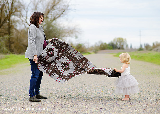 family portraits with mommy and daughter and a navajo blanket