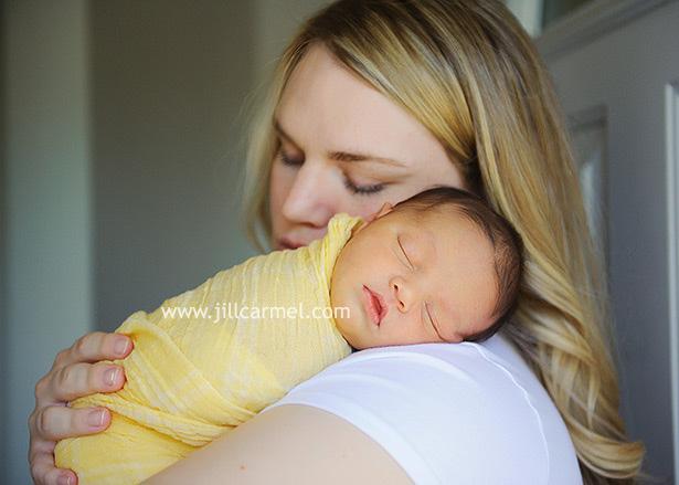 all sleepy and cuddled into mommy for sacramento newborn portraits