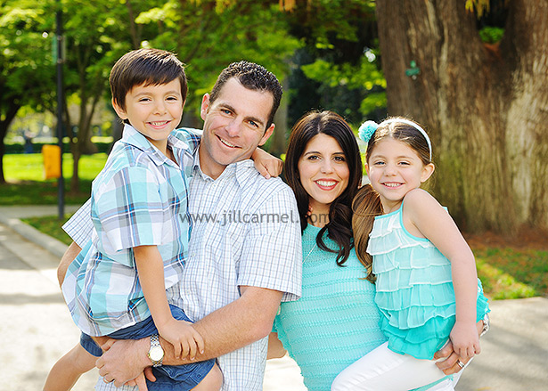 sacramento family hugging and all dressed up in aqua and plaid for their spring portrait