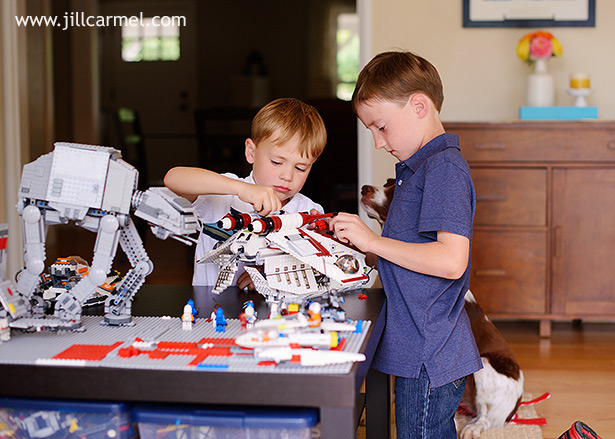 boys playing with their star wars legos perfect for lifestyle family pictures