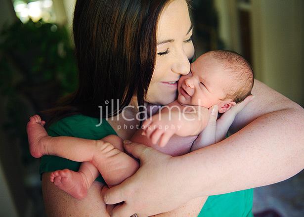 newborn baby having fun cradled in sacramento mommy's arms