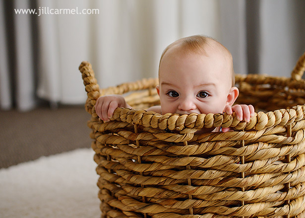 baby in a basket in the loft studio