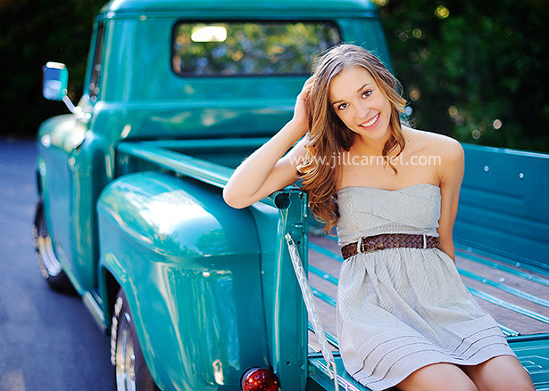 high school senior sitting in a blue old fashioned truck for her portraits in sacramento